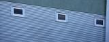 Windows in Blue Steel Wall