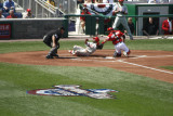 Pudge tags out Rollins at the plate