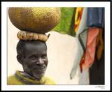 3/10/06 - Market Dayds20060310 _0105awF Man with Fruit.jpg