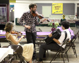 Fishtank Ensemble practices backstage