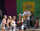 David John of Handful of Lovin' sings to some dancers