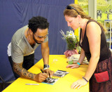 Leroy Bell signs a CD for a fan