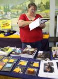 Donna checks in Tommy Emmanuel merchandise