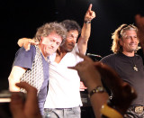 Marke Clarke, Billy Squier and keyboard player thank the crowd