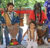 Sidiki Diallo (right), Caleb (left), and future drum master (center). Sidiki died in Dec. 2010