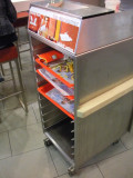 Fast food does not have trashcans. This is the trash, slide your tray in here.