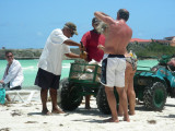 Making coconut drinks on the beach