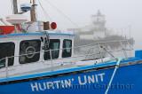 Blue boat in fog at Fishermans Cove Eastern Passage Halifax Nova Scotia