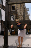 Tourist Pilloried in wooden stocks in Old Halifax Nova Scotia
