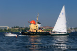 Tourist tugboat sailboat and motorboats in Halifax harbour Dartmouth Nova Scotia