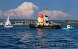 Tourist tugboat and sailboat in Halifax harbour Dartmouth Nova Scotia