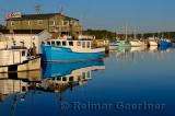 Fishing boats at sunrise at Fishermans Cove Eastern Passage Halifax Nova Scotia