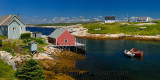 Houses in the quiet fishing village of Peggys Cove Nova Scotia in full sun