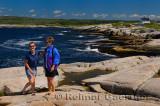 Tourists on the granite rocks of Peggys Cove at St Margarets Bay Nova Scotia