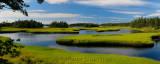 Panorama of tide pool water with salt marsh cordgrass on Cape Sable Island Nova Scotia