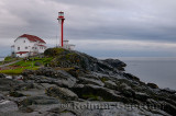 Cape Forchu lighthouse and wet rocks near Yarmouth Nova Scotia