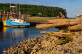 Old dock and Owls Head cliff at sunset on the Bay of Fundy Alma New Brunswick