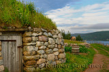 Clydesdale horse and door of Black House with sod roof and stone walls at Highland Village Museum Iona Cape Breton