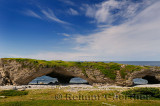 Tourist at the Arches Provincial Park Newfoundland Canada with Gulf of St. Lawrence