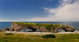 Tourists at the Arches Provincial Park Newfoundland Canada with Gulf of St. Lawrence