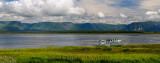 Panorama of abandoned boats at Parsons Pond Newfoundland with Gros Morne Long Range Mountains