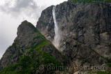 Detail of Pissing Mare Falls at east end of Western Brook Pond with steep cliff fjords at Gros Morne National Park Newfoundland
