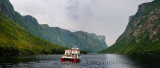 Panorama of boat tour on Western Brook Pond with steep cliff fjords at Gros Morne National Park Newfoundland