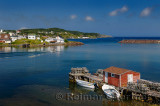 Quiet water of Twillingate Harbour Newfoundland with lobster traps on dock and village houses