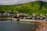 Motorboat entering breakwater at Petty Harbour-Maddox Cove Avalon Peninsula Newfoundland