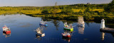 Panorama of model ships and lighthouse on river between Mobile and Witless Bay Newfoundland