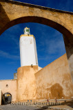 Minaret of the Grand Mosque Old Portuguese city El Jadida Morocco through an archway