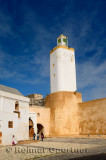 School children walking through the courtyard of the Grand Mosque Old Portuguese city El Jadida Morocco