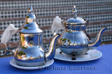 Sweet and unsweetened mint tea in silver teapots outdoors at Oualidia Morocco