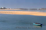 Boat seagulls and surf on the Atlantic ocean coast of Oualidia Morocco