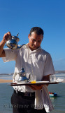 Server pouring mint tea for lunch at seaside resort at Oualidia Morocco
