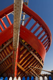 Red wooden boat under construction at the Essaouira Port in Morocco