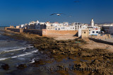Atlantic coast and North bastion and ramparts of Essaouira Morocco viewed from Sqala du Port