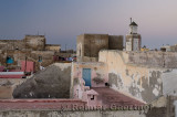Soft pastel pink and blue at dawn over rooftops of Essaouira Morocco