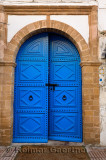 Fresh painted blue door with stonework at Riad Al Madina in Essaouira Morocco