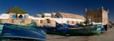 Panorama of blue and green fishing boats for sale at Sqala du Port Essaouira Morocco