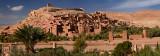 Panorama of Ait Benhaddou and blue berbers crossing Wadi Mellah near Ouarzazate Morocco