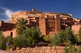 Blue Berber man at historic earthen ksar of Ait Benhaddou near Ouarzazate Morocco