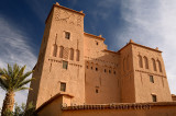 Refurbished historic Kasbah Ait Ben Moro with Palm and Olive tree at Skoura Morocco