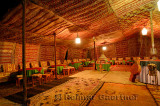 Large empty carpeted Berber tent at night in Tinerhir Morocco
