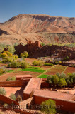 Red soil of Kasbah ruins and cultivated fields in Dades Gorge Morocco