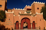 Front of Hotel Kasbah Lamrani berber architecture style of red adobe fortress Morocco