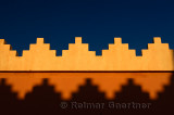 Abstract pattern of crenellations of yellow orange and blue sky Morocco