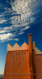 Texture and pattern of Berber pise architecture with chimney at sunrise in Tinerhir Morocco