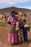 Nomadic Berber mother and children with Arabian camels Morocco