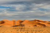 Metal chairs of Auberge du Sud in the sand dune desert of Erg Chebbi Morocco